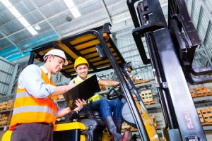 33784455 - asian fork lift truck driver discussing checklist with foreman in warehouse